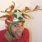 Guy wearing moose racing hat in ugly Christmas sweater
