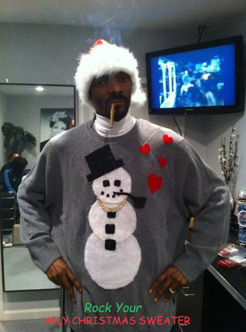 Photo: Snoop Dogg, now Snoop Lion, in an ugly Christmas sweater smoking