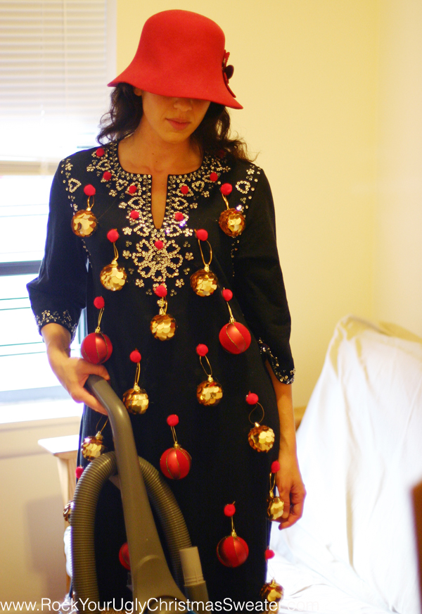 Picture of a woman vacuuming in ugly Christmas sweater dress