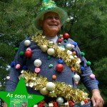 Picture of guy in tree ugly Christmas sweater