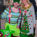 Guy in elf costume and lady in ugly Christmas sweater dress