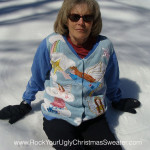 Woman in angel ugly Christmas sweater making snow angels