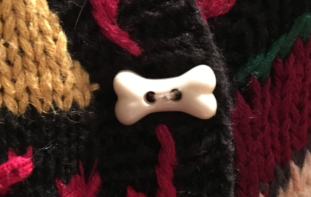 Bone clasp on Spot ugly Christmas sweater