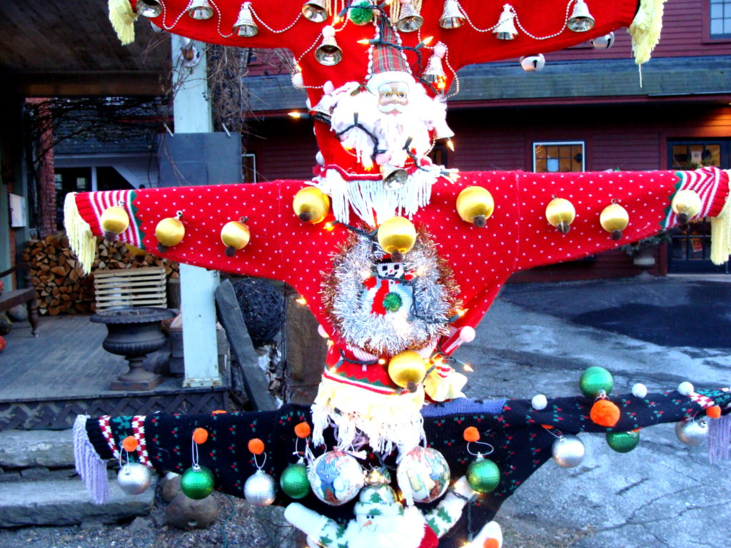 Ugly Christmas sweater totem pole at Fossil Glass, Woodstock, Vermont